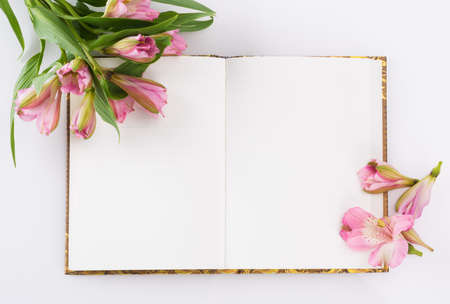 Valentines day, Mothers day composition. Love diary and fresh spring flowers. White background and copy space