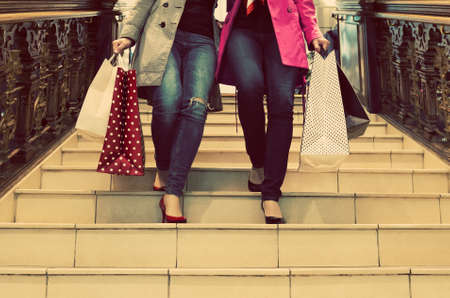 Two unrecognisable young female friends enjoying a day out shopping