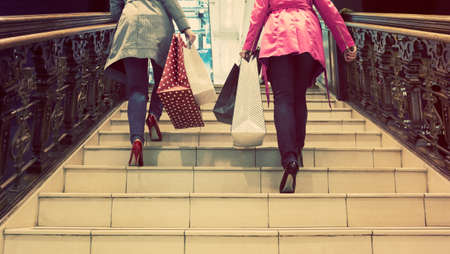 unrecognisable: Two unrecognisable young female friends enjoying a day out shopping