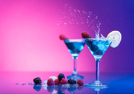 Colourful cocktails garnished with berries