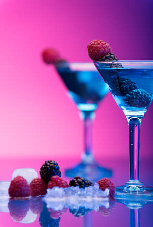 garnished: Colourful cocktails garnished with berries