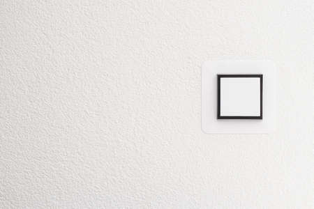 switch on the light: Interruptor de luz en la pared blanca, detalle tiro con copia espacio