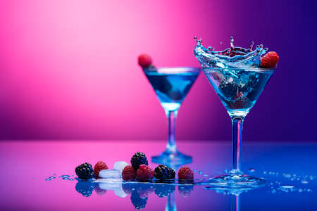 Colorful cocktails garnished with berries