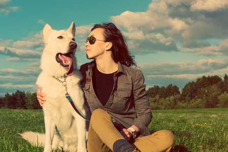 Young attractive girl with her pet dog, colorised image