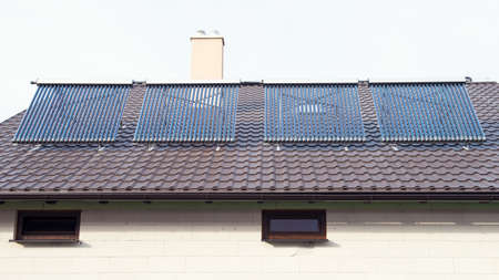 gelio: Vacuum solar water heating system on a house roof.