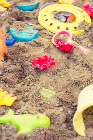 plastic scoop: Plastic children toys in sandpit or on a beach