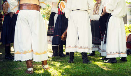 anonymous people: Anonymous young people in folklore costumes Stock Photo