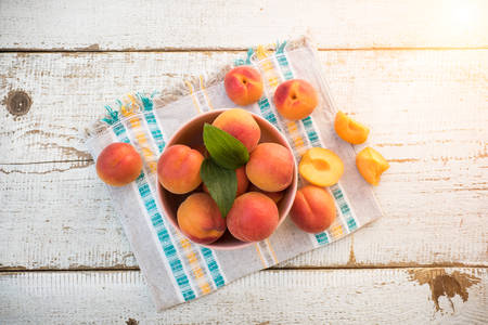 homegrown: Fresh homegrown apricots on vintage white wooden table, view from above