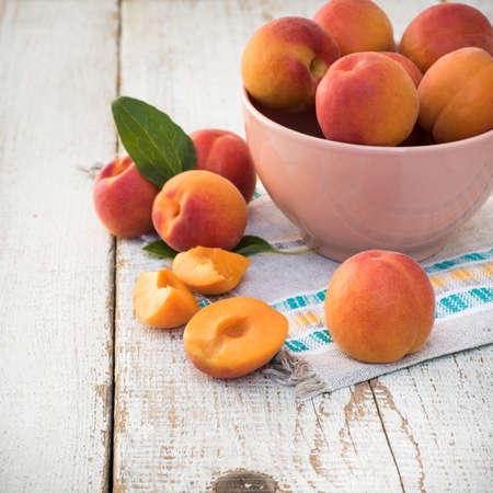 homegrown: Fresh homegrown apricots on vintage white wooden table