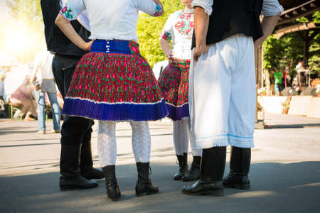 anonymous people: Anonymous group of people in folklore costumes Stock Photo