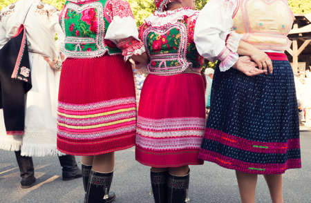 frienship: Anonymous senior female friends in folklore costumes