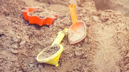 sand mold: Plastic children toys in sandpit or on a beach