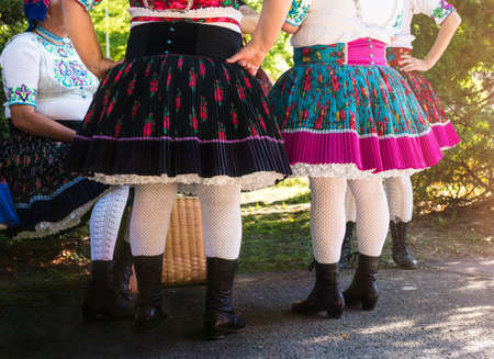 anonymous: Anonymous senior female friends in folklore costumes