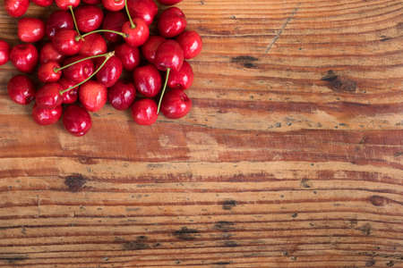 homegrown: Ripe organic homegrown cherries on wooden background