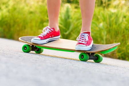 anonymous: Anonymous teenage girl with skateboard