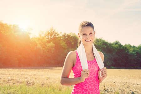 taking a break: Attractive female taking a break after jogging