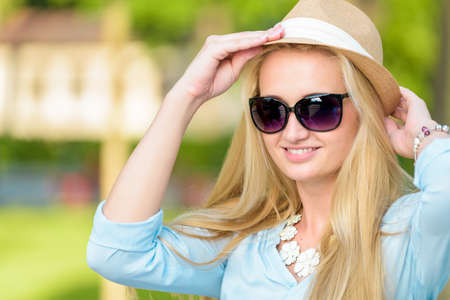 smilling: Portrait of an attractive young blond woman smilling Stock Photo
