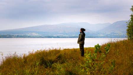 loch lomond: Hipster man standing by Loch Lomond, Scotland, UK
