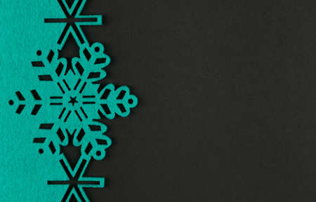 holiday backgrounds: Unusual design christmas background with turquoise snowflakes and copy space on dark grey background