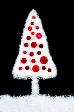 xmas background: Snow covered Xmas tree on black background Stock Photo