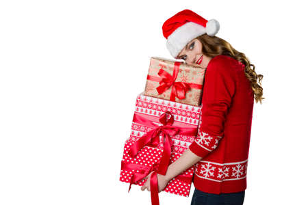 wrapped present: Gorgeous girl holding beautifully wrapped presents, xmas concept on white background