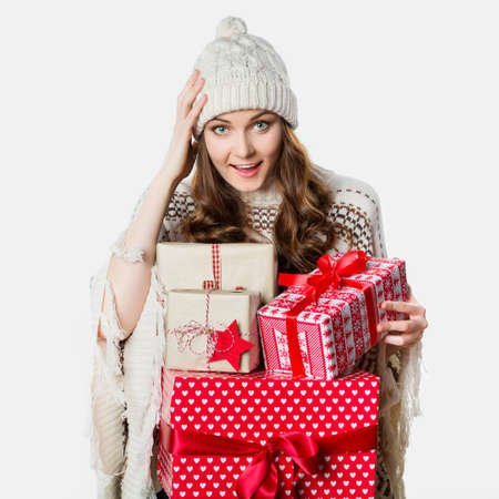 stunned: Gorgeous girl holding xmas presents, stunned, funny xmas concept