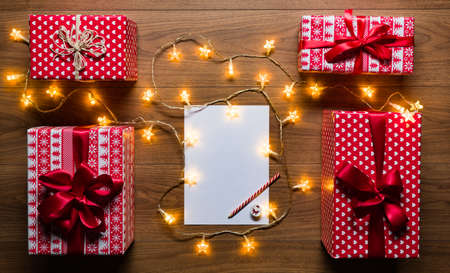 Desk view from above with letter to santa, presents and christmas lights, retro xmas concept with copy space Stok Fotoğraf - 48887971
