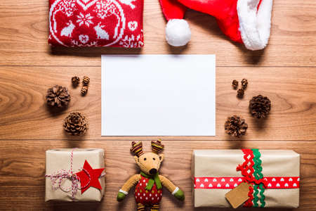 copy writing: Desk view from above with empty letter to santa and presents, retro xmas concept with copy space Stock Photo