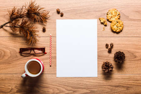 Magical christmas theme background, pine cones, coffee, cookies and an empty letter to santa on wooden table Banco de Imagens