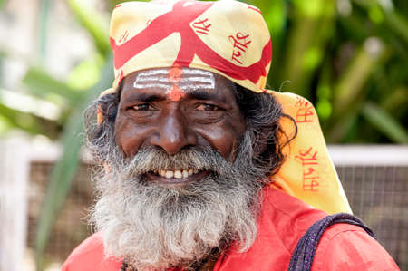 sadhu: Goa, India - January 2008 - Smiling portrait of an Indian sadhu, holy man, with traditional painted face