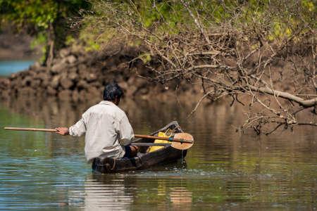 india fisherman: GOA, INDIA - Indian fisherman on a boat