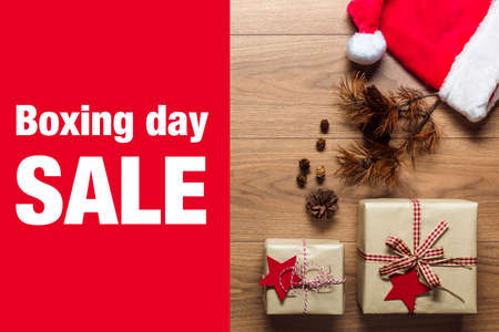 boxing day sale: Beautiful presents, Boxing Day sale concept, desk with santa hat, view from above