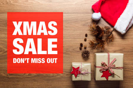 Beautiful presents, xmas sale concept, desk with santa hat, view from above