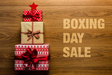 Boxing day Sale concept on wooden background, view from above 스톡 콘텐츠
