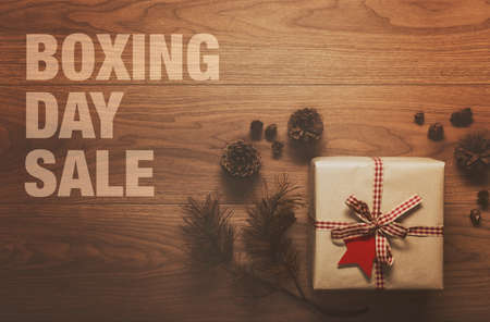background settings: Boxing Day Sale theme background, on wooden table