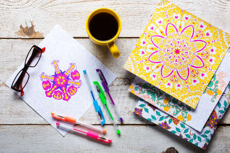 adult care: Adult coloring books, stress relieving trend, mindfulness concept Stock Photo