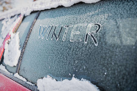 inconvenience: Frozen car window, car parked outside, winter transport issues