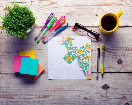 Retro desk with adult coloring books, stress relieving trend, mindfulness concept 스톡 콘텐츠