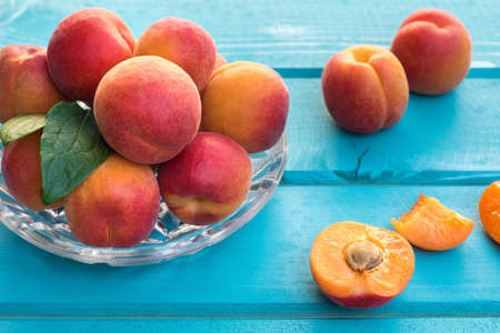homegrown: Fresh homegrown apricots on pastel blue wooden table