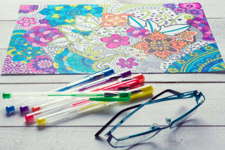 Adult coloring books, new stress relieving trend 스톡 콘텐츠