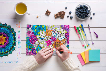 Flat lay, female coloring adult coloring books, new stress relieving trend Stok Fotoğraf - 56351804