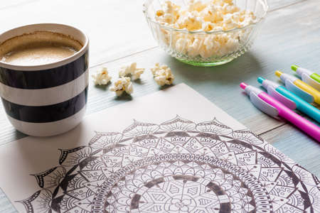 lay: Adult coloring books, new stress relieving trend Stock Photo