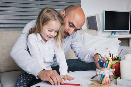 spontaneous expression: Father and daughter drawing together, creativity and learning concept Stock Photo