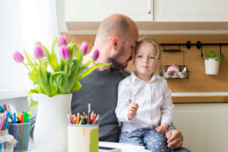 spontaneous expression: Father and daughter in the kitchen, fathers day concept, real family