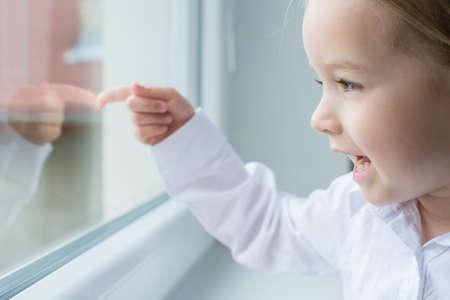 pre school: Cute blond pre school girl portrait, looking ou of the window