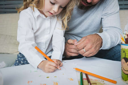 Father and daughter drawing together, creativity and learning concept Stock Photo