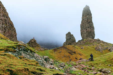 Photographer taking a picture for an outdoor campaign, The old man of Storr