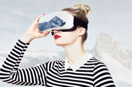 Attractive woman wearing virtual reality glasses. VR headset. Virtual reality travel concept.