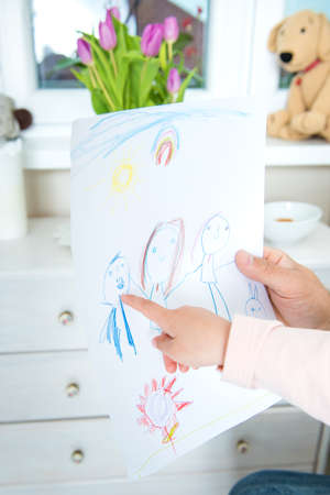 Cute blond girl giving her father a drawing, fathers day concept Stock Photo