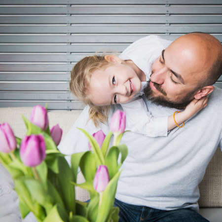Happy family concept, father and daughter portrait, sitting on a couch having fun Stock Photo